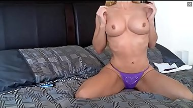 mature like a cougar in a purple bikini