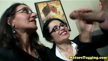 Spex matures tugging hard cock together