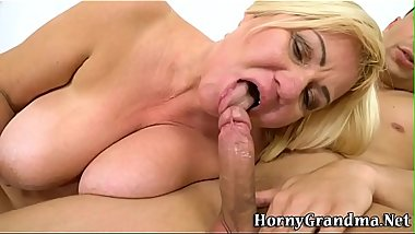 Granny gets jugs spermed riding and sucking
