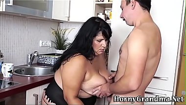Titfucking busty granny gets pounded
