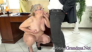 Buxom cougar blows cock