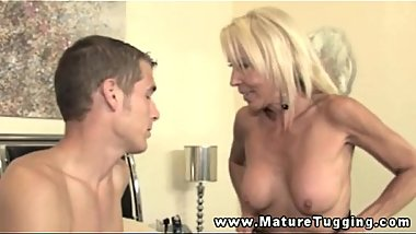 Mature busty blonde wanks younger man