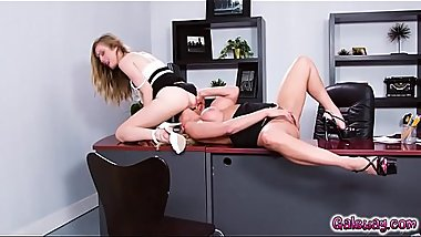 Katie Morgan on the desk with her legs spread wide and Karla dives in!