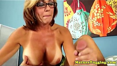 Tanlined mature playing with dick